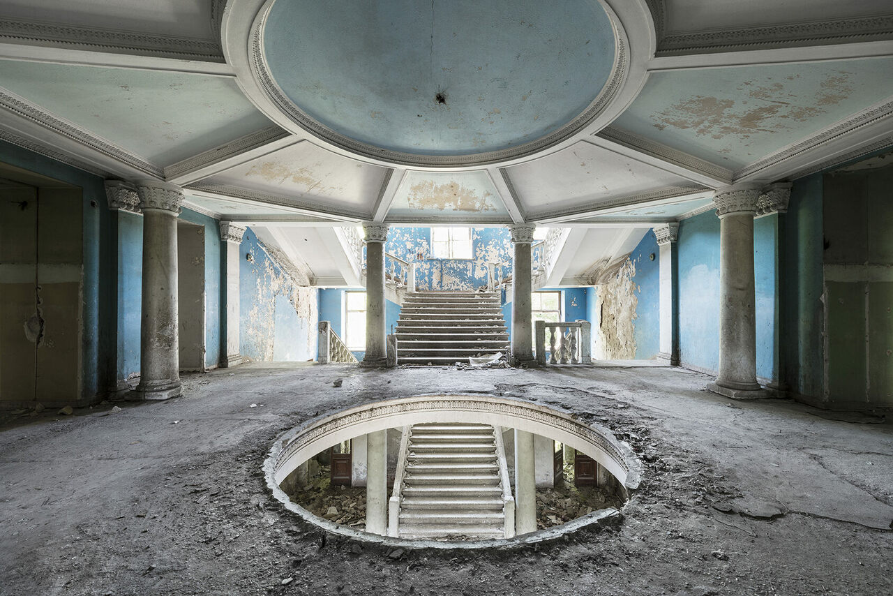 The grand entrance hall inside a neglected sanatorium in Georgia. This building is slated to be redeveloped into a luxurious hotel.
