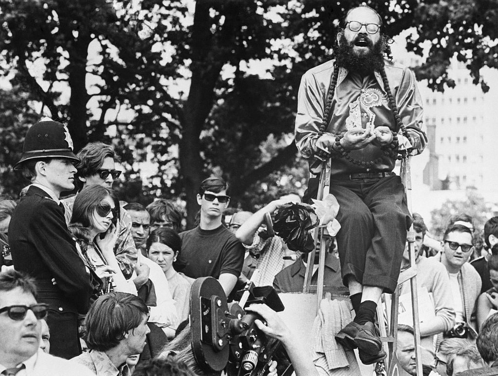 "Allen Ginsberg chants in London. Although his reading displays many of the technical attributes of ""Poet Voice,"" it generally doesn't come across that way to listeners."