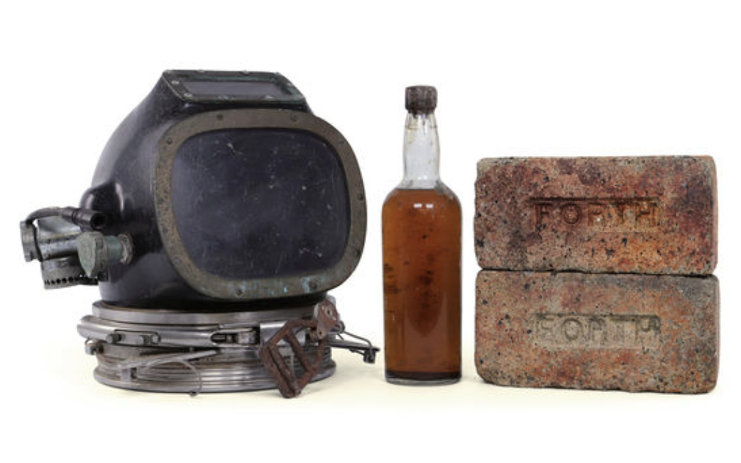 The full auction lot includes original bricks from the ship and a diving helmet.