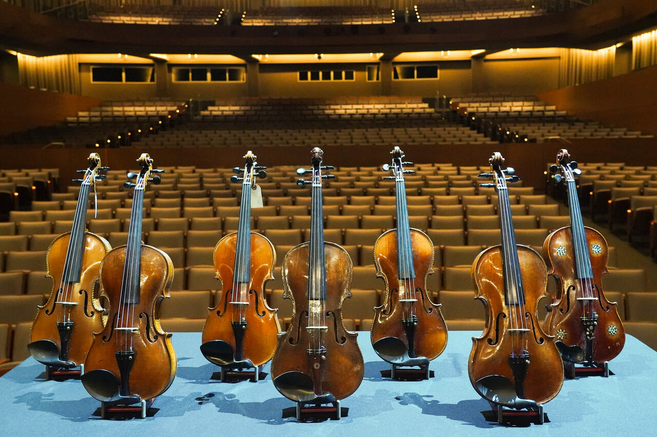 Some of the Violins of Hope on the stage of The Soraya.