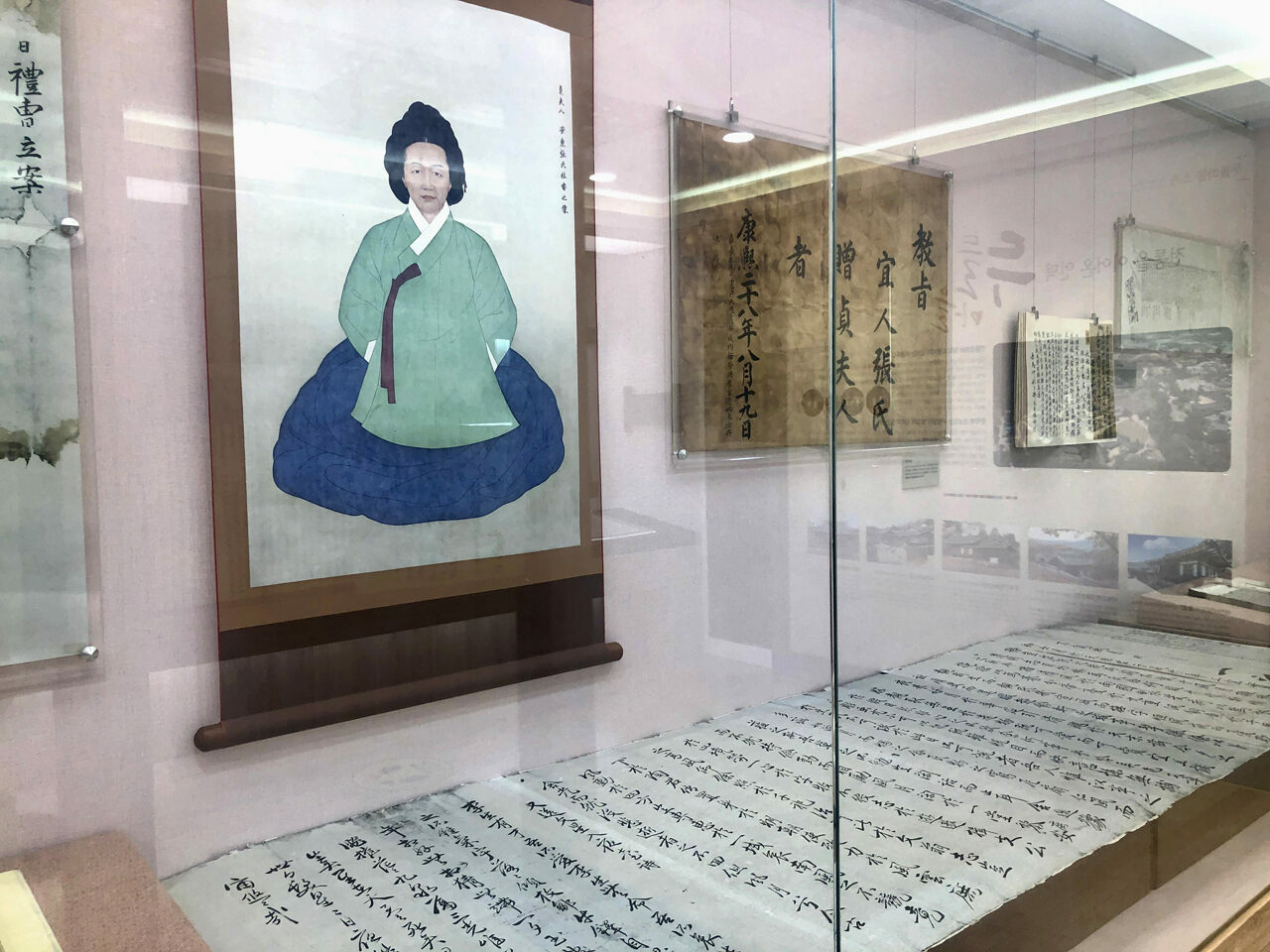 A portrait of Jang Gye-hyang hangs in the Eumsik-Dimibang Exhibition Center.