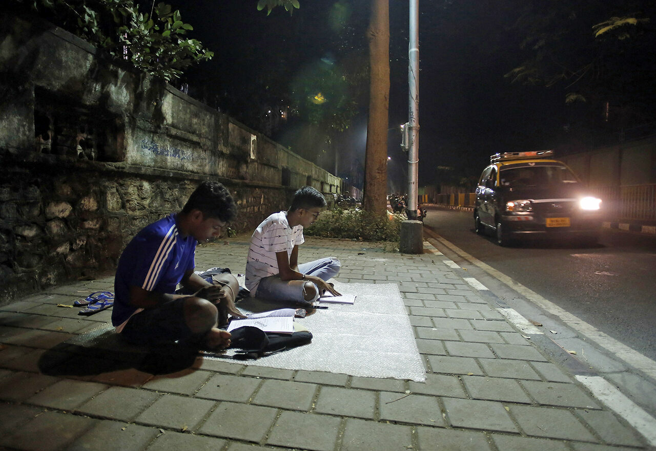 "At ""study corners"" like Abhyas Galli, near the busy junction of Worli Naka in Mumbai, two students enjoy the peace and quiet they can't find at home."