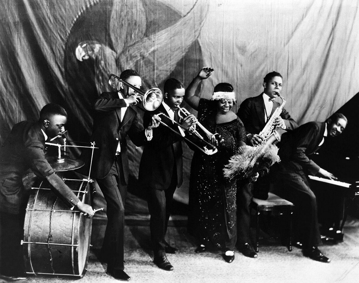 Ma Rainey poses for a studio group shot with her Georgia Jazz Band in 1924 or 1925.