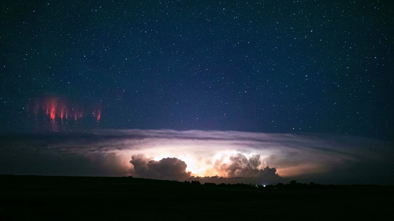 When red sprites, pictured here above Nebraska, are accompanied by a diffuse, dome-shaped glow, it can look like a jellyfish is hovering in the sky.
