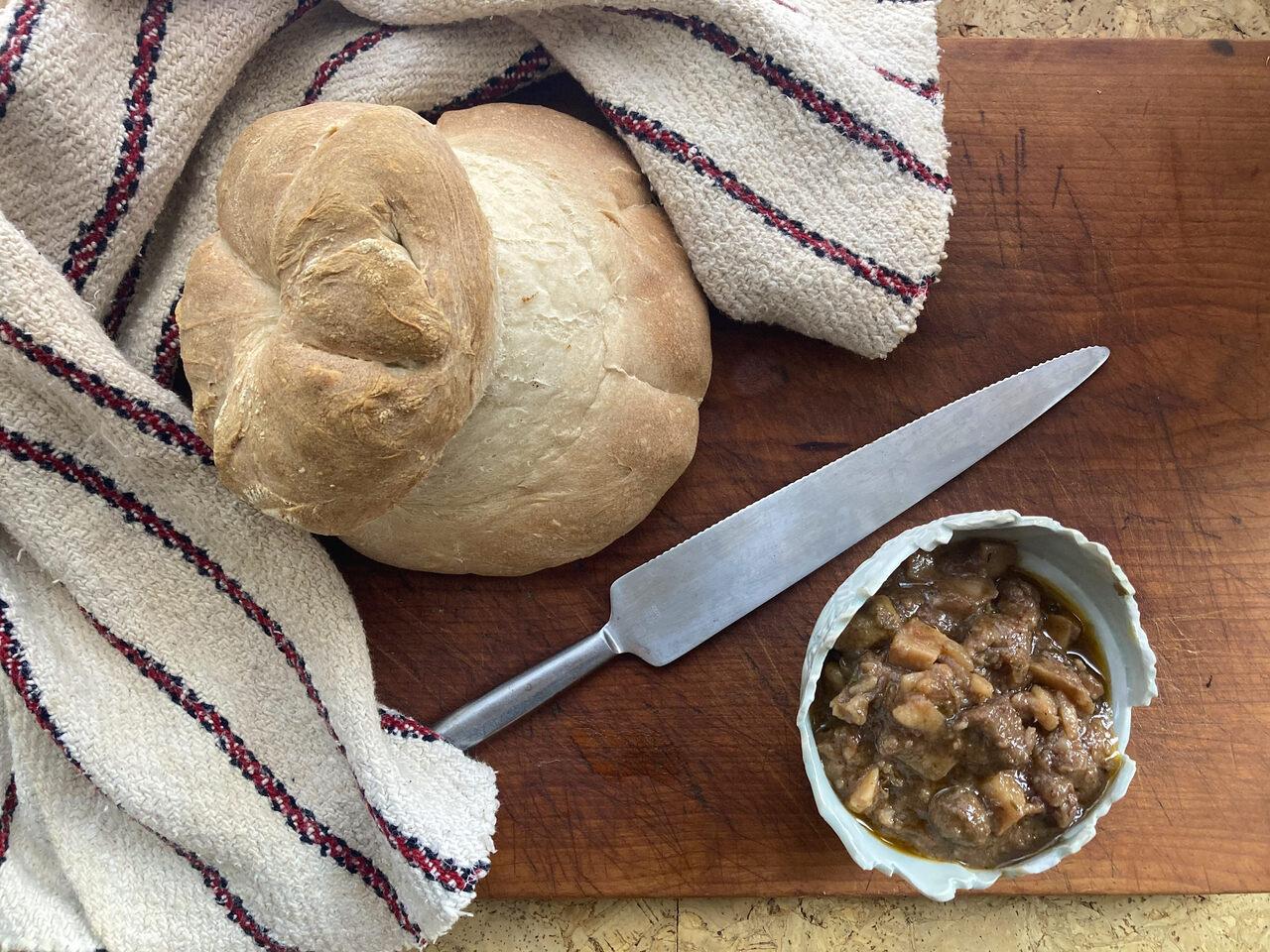 The finished cottage loaf, left, with a simple version of <em>boeuf en daube</em>.