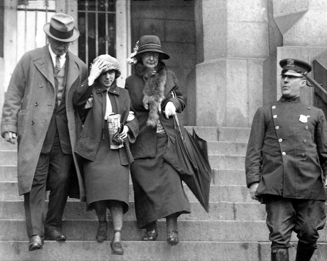 Celia Cooney, the infamous Bobbed Haired Bandit, was a symbolic figure of female empowerment in the 1920s. Here, she is seen leaving the courthouse.
