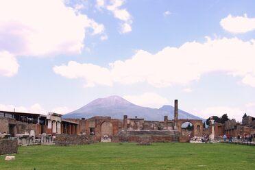 Vesuvius rising above the city it laid to ruin.