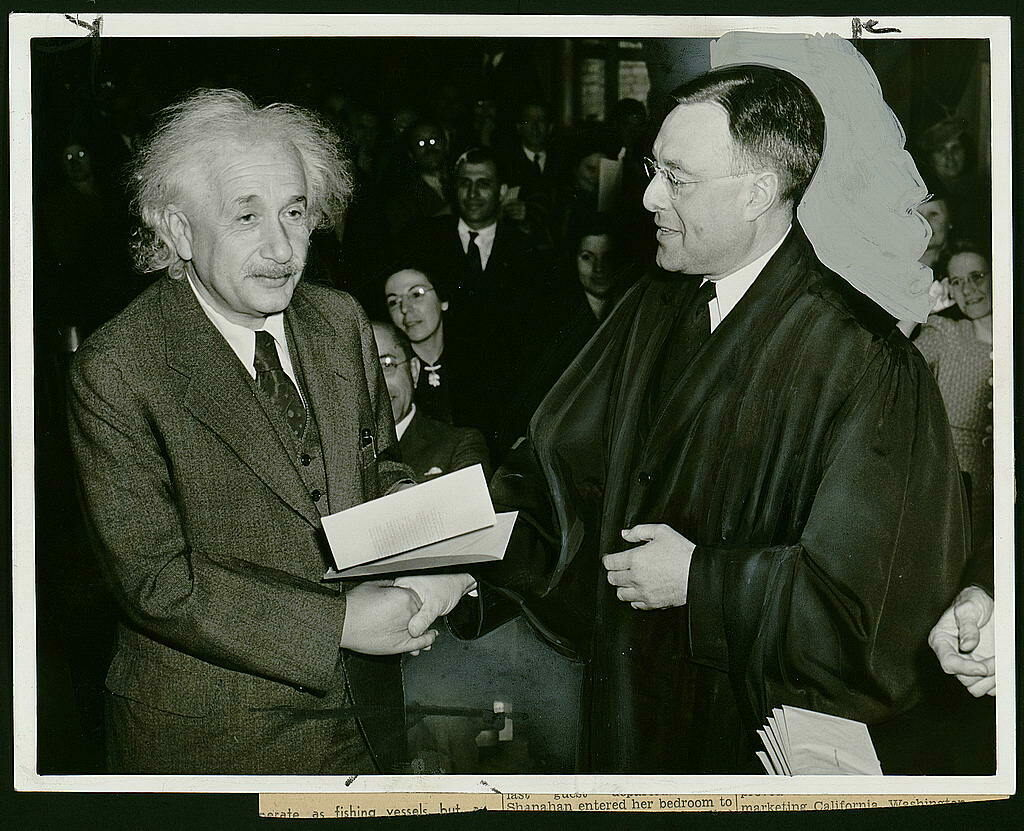 Albert Einstein receiving his certificate of American citizenship from Judge Phillip Forman in 1940.