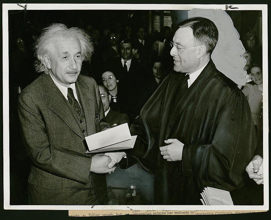 Albert Einstein receiving his certificate of American citizenship from Judge Phillip Forman in 1940.