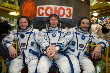 Scott Kelly (left) and Mikhail Kornienko (right), with cosmonaut Gennady Padalka, just before setting off on the one-year mission.