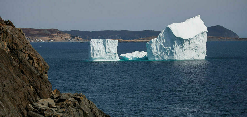 An iceberg floats off the coast of Port Kirwan in Newfoundland, Canada, in the stretch known as Iceberg Alley.