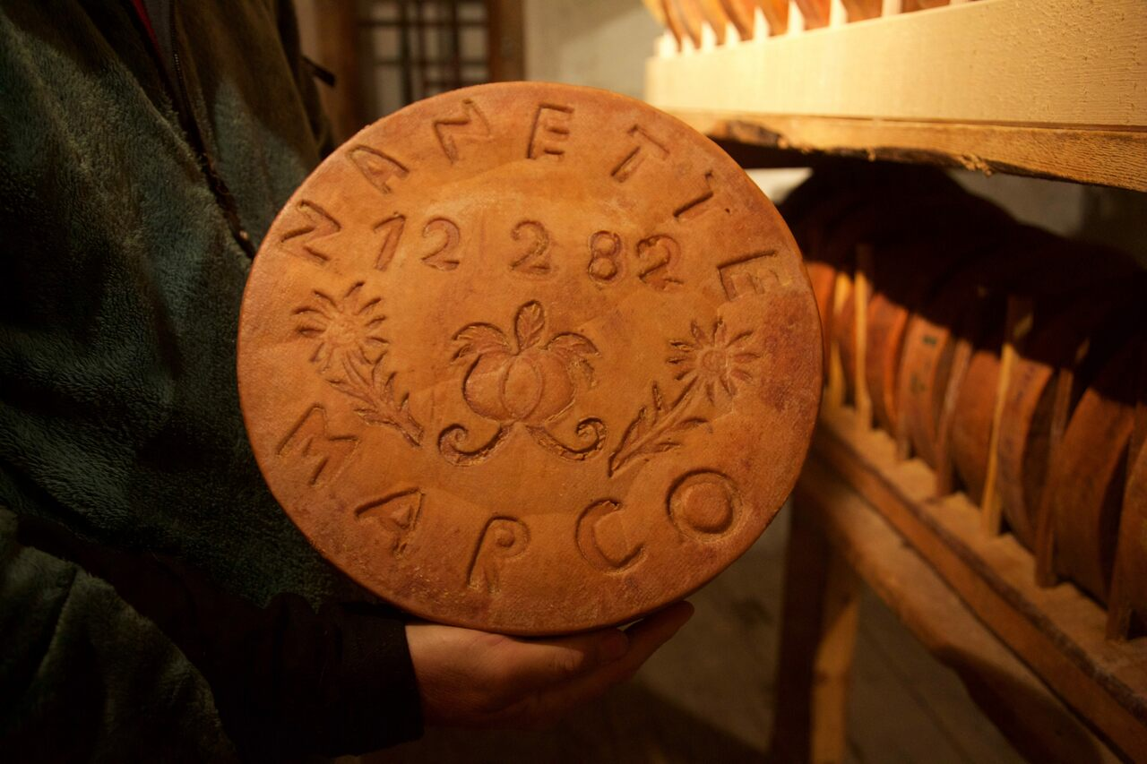 One of Zufferey's engraved wheels of cheese.