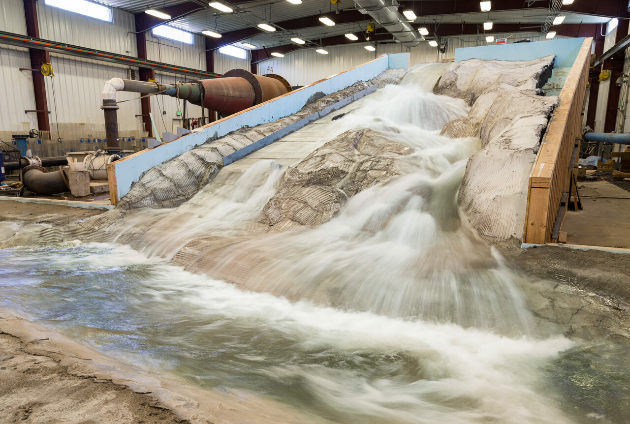 The model is an exact, scale replica of the damaged spillway.