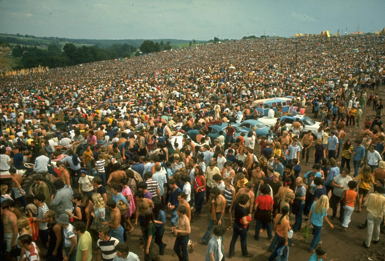 The crowd was much, much bigger than expected, which helped turn a music festival into the stuff of legend.