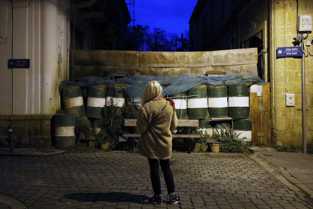 A young woman stands near the barricades of the U.N. buffer zone in the Greek-Cypriot part of Nicosia.