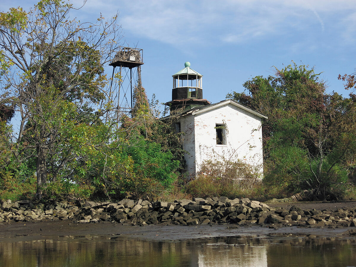 Fishing Battery Lighthouse in Maryland. The light was transferred to the tower in 1928; the original structure remains dilapidated.