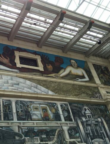 Diego Rivera's mural sprawls across a light-flooded room in the Detroit Institute of Arts.