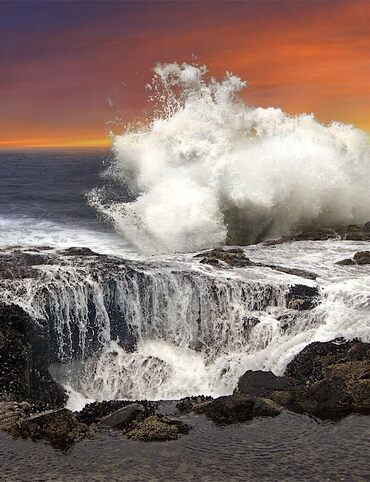 Waves crash against the rocks near Thor's Well in Oregon.