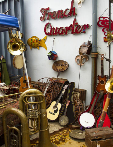 Musical instruments in the courtyard of SecondLine Arts and Antiques in New Orleans' French Quarter.