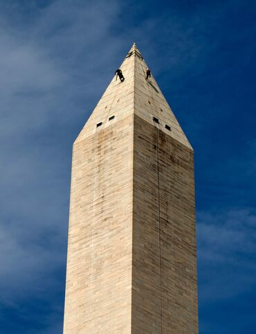 Workers assess the exterior of the Washington Monument after an earthquake in 2011.