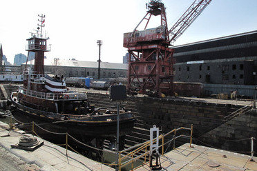 A boat being serviced using a dry dock. (amberjol/Flickr)
