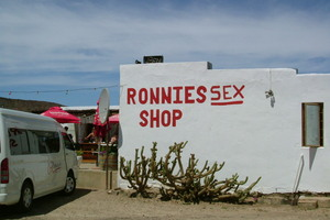 "Red ""Ronnies Sex Shop"" lettering"