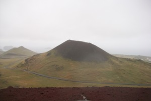 Helgafell, the supposedly dormant volcano, seen from the slopes of Eldfell, the volcano created by Helgafell's eruption.