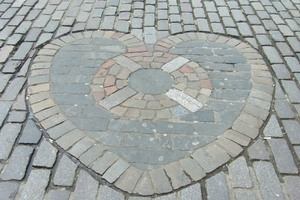 The Heart of Midlothian marks the former entrance to the Old Tolbooth.