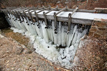 The sluice leading to the mill wheel leaks profusely, creating an ice cave underneath the scaffolding from around December to February. (Joel Simpson/Atlas Obscura)