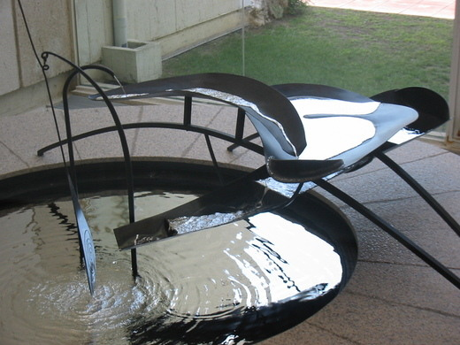 Images of Four Wings and Mercury Fountain by Calder