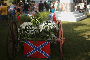An antique wagon is decorated with the Confederate flag during the annual Festa Confederada