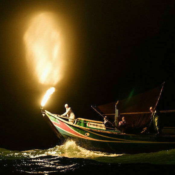 A fire-fishing boat lures sardines to the surface off the coast of Taiwan.