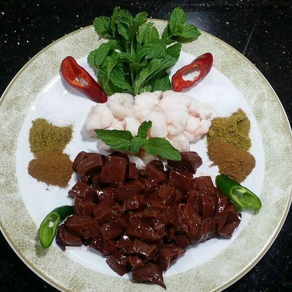 Cubes of liver with tail fat, mint, and spices.