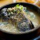 "Korean ginseng, black chicken, and rice soup known as ""ogolgye samgyetang."""