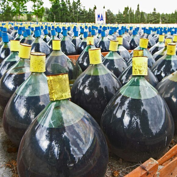 Rows of glass demijohns of Rivesaltes.