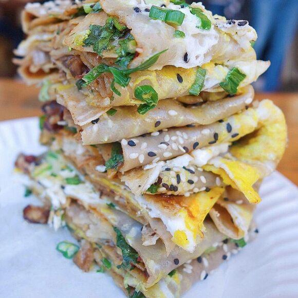 Eggs, hoisin sauce, chili, cilantro, sesame, crunchy wontons, and peking duck.