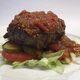 A burger slathered with monkey gland sauce.