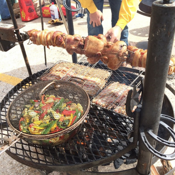 Bacon-wrapped squirrel, grilling at the 2014 World Champion Squirrel Cookoff.