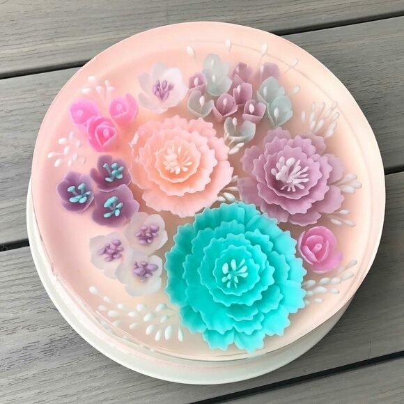 Vibrant jelly flowers fill jelly cakes.