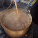 At Sahu, chai boils over coals.