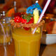 A zombie garnished with fresh fruit and sugar.