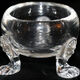 An English crystal salt cellar from circa 1720, embellished with three lion heads.