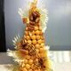 Ornate confectionary decorates this New Year's croquembouche.