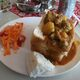 A quarter mutton bunny chow, complete with sides, in Durban, South Africa.
