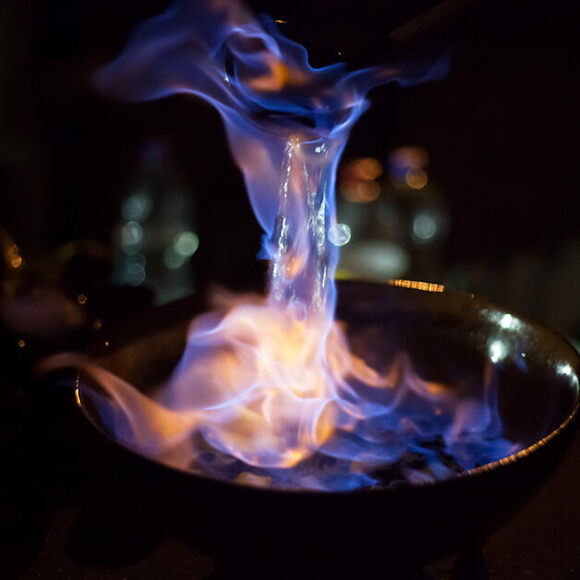 The captivating blue flame of queimada.