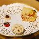 Lasagna, lattice pie, a stuffed half-cranberry, and a mini chocolate chip cookie.
