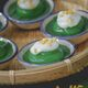 Pandan and mung bean topped with coconut cream.