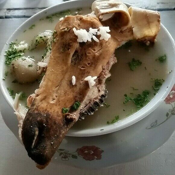 Some bowls of caldo de cabeza come topped with half a sheep's face.
