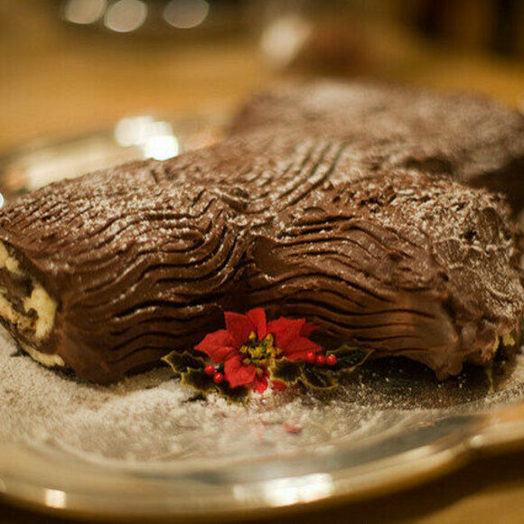 The frosting on Yule log cakes is combed to resemble bark.