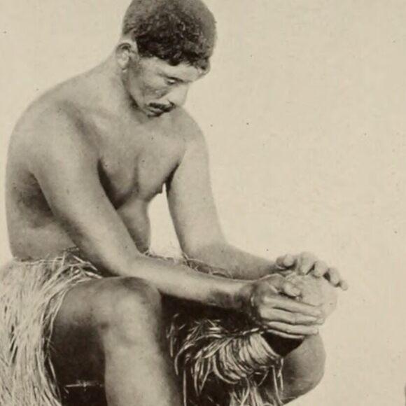 Grating coconuts using a coconut grater school in Tahiti, circa 1911.